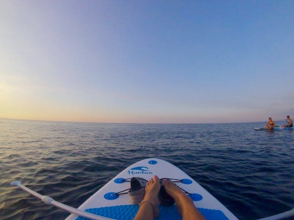 Standup paddle boarding during sunset