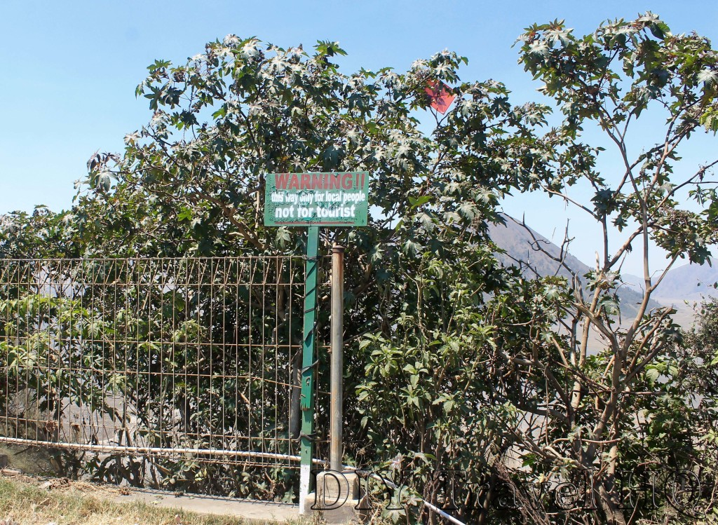 Green fence free entrance to Mount Bromo