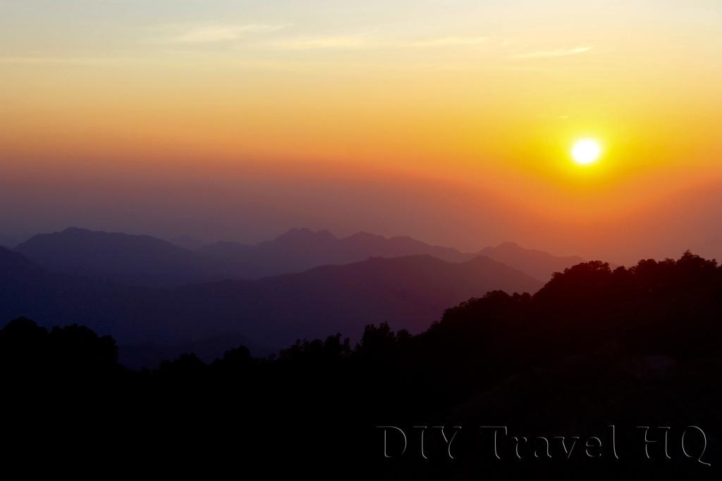 Watching sunrise on Mt Kelimutu