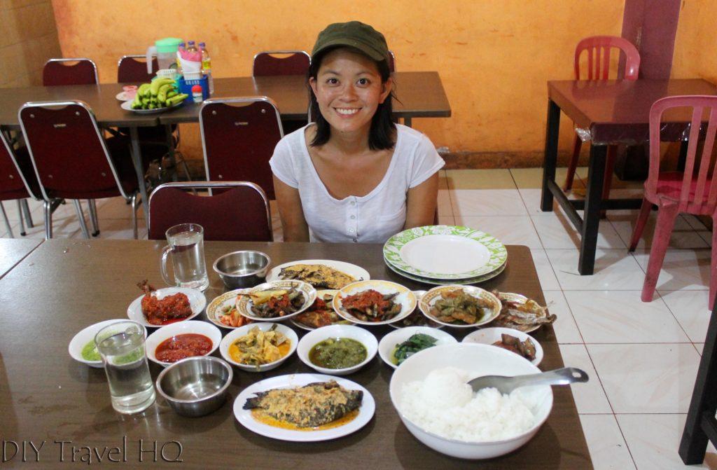 Tourist eating padang food Bukittinggi