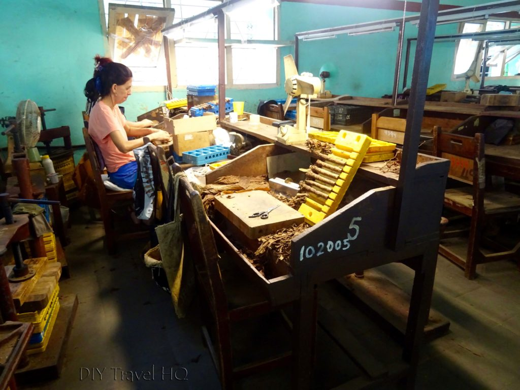 Cigar factory worker at her desk