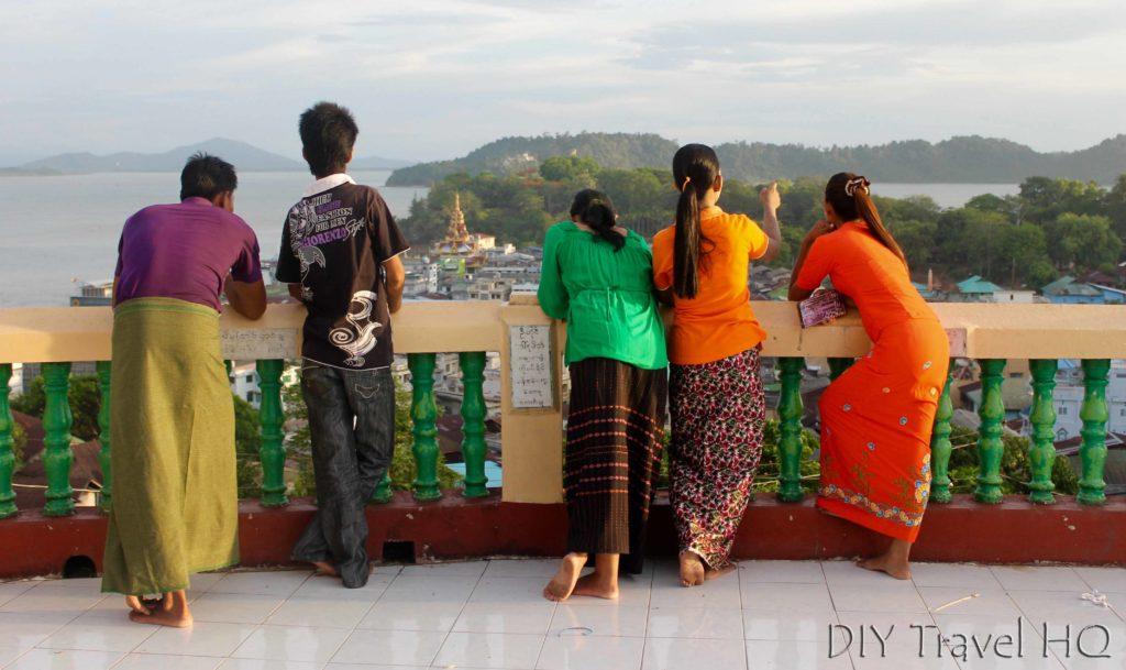 Burmese in traditional longyi clothes
