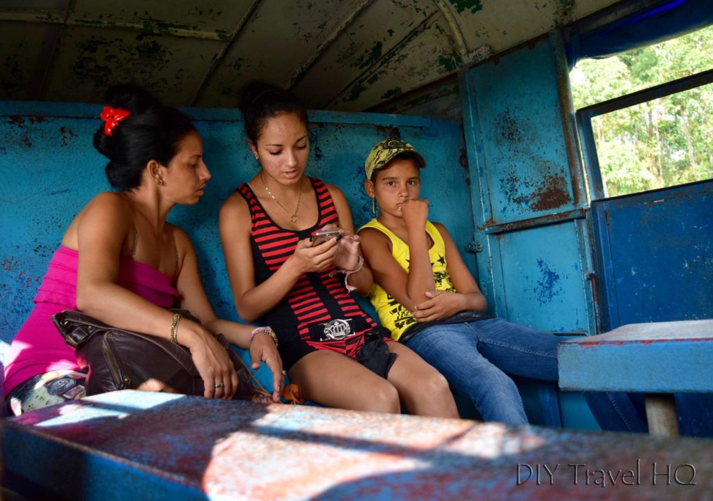 Family inside camion in Cuba