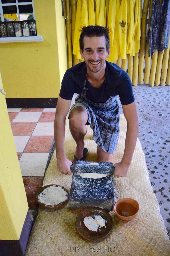 Erik using traditional stone grinder