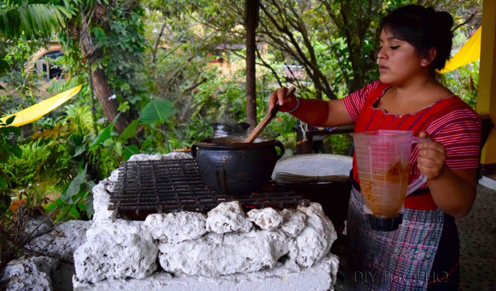 Stirring Pepian Chicken