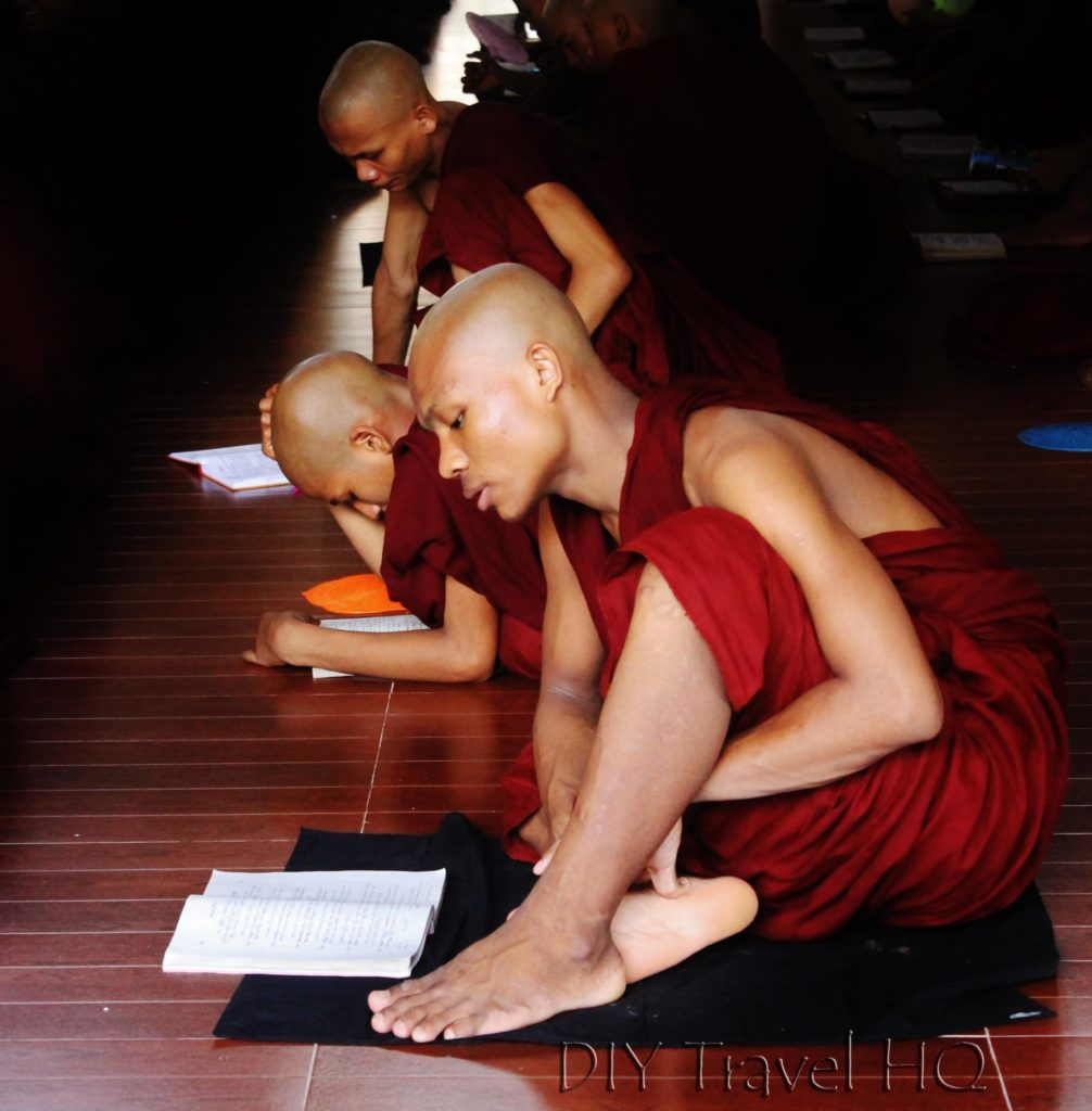 Monk studying at monastery