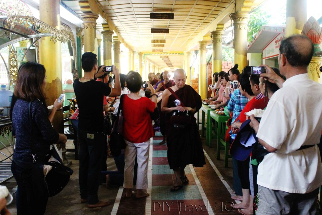 Tourists taking photos of Monk lunch