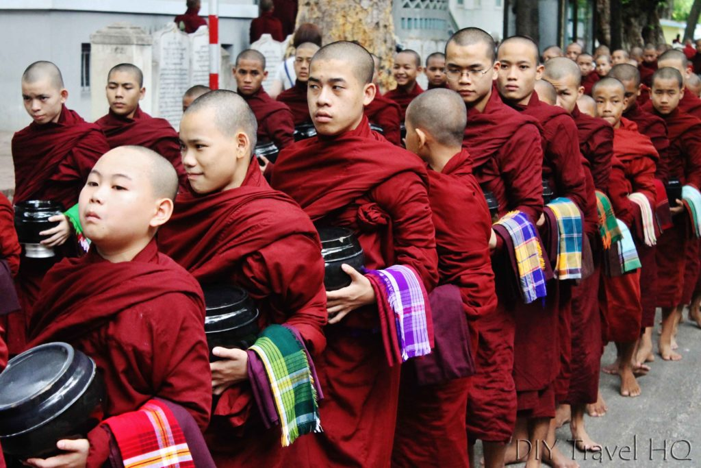 Monks with alms bowls in line