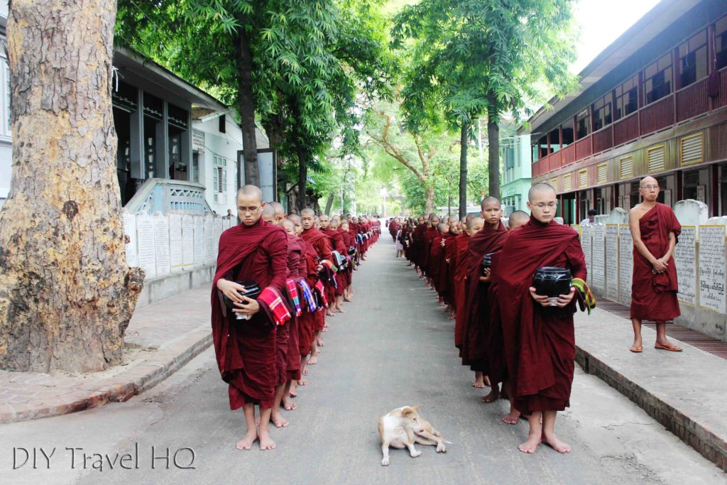 Monks lining up for lunch on street