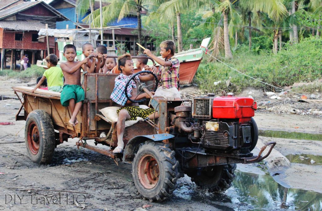 Myanmar kids riding a tractor