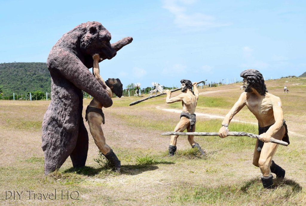 Cavemen being attacked by a bear!