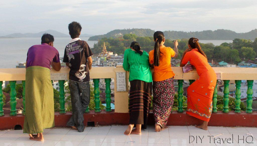 Burmese in colourful longyi