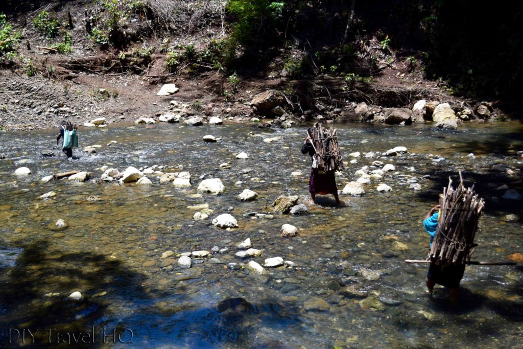 Locals Crossing Finca el Paraiso Stream with Wood on Backs