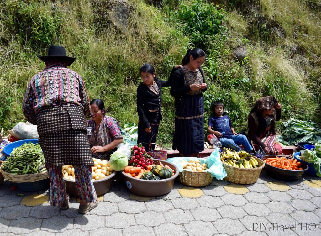 Solola Man in Traditional Clothing Buying Vegetables