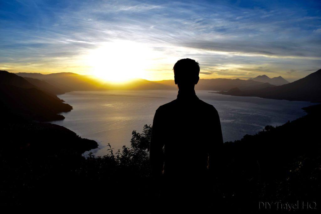 Tourist Watching Sunrise Over Lake Atitlan from Indian Nose
