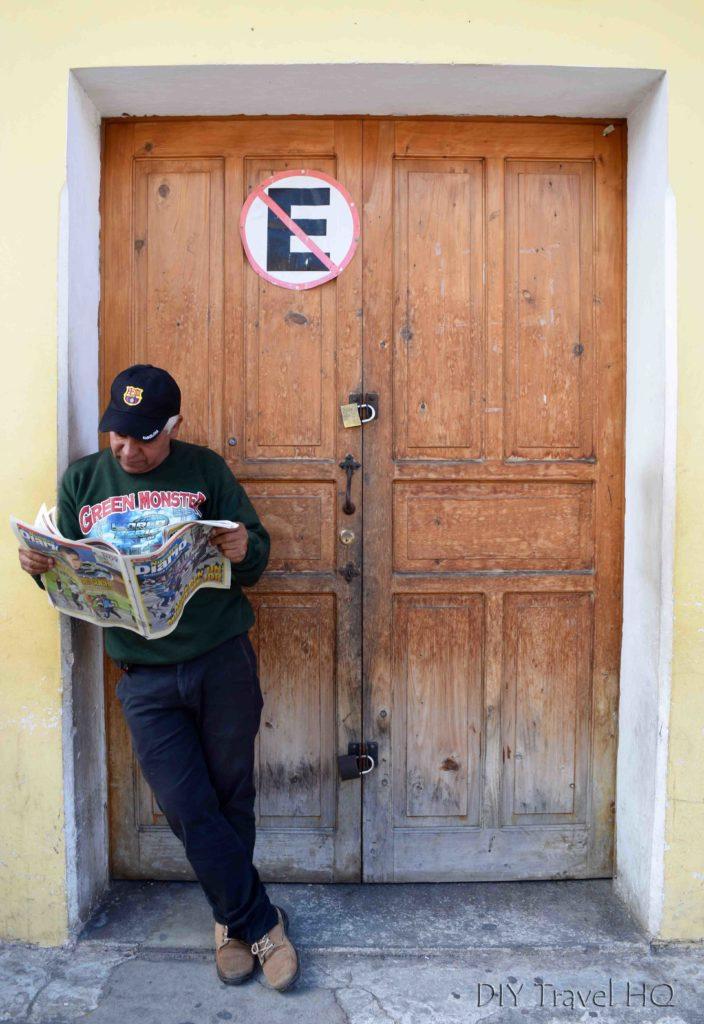 Antigua Photo Walk Street Photography Man Reading Newspaper
