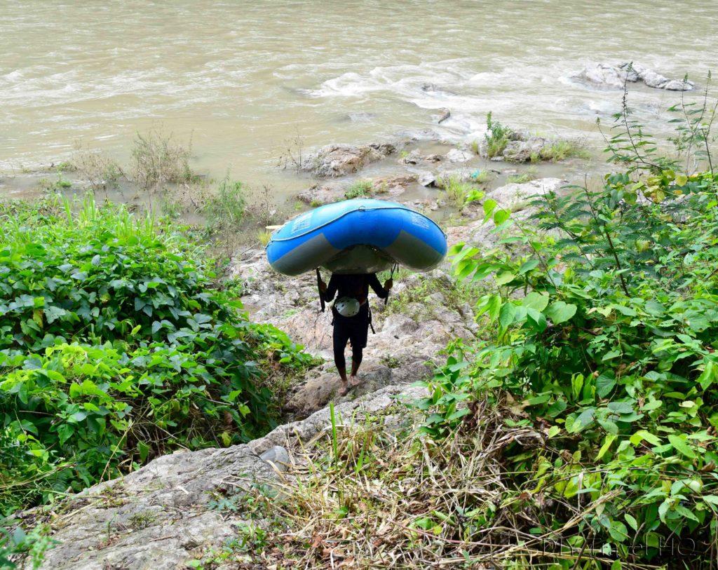 La Moskitia Ecoaventuras Guide Carrying the Raft