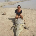 Parc Crocodile de Bazoule: Sitting on an African Croc!