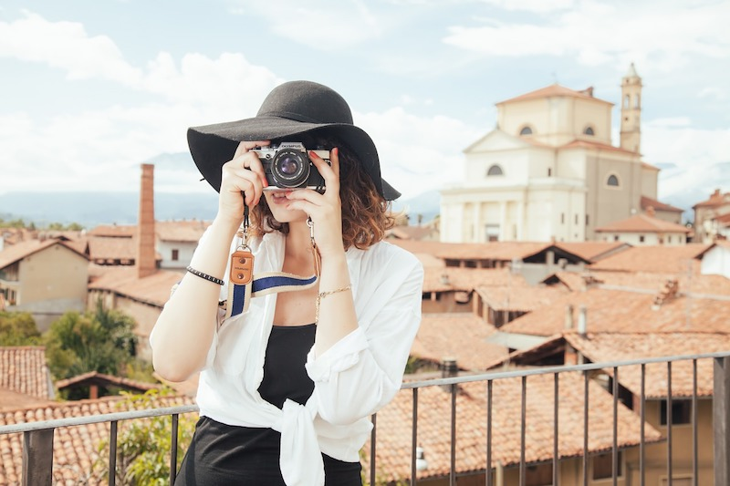 Woman taking a photo on holiday