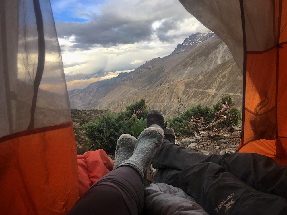 Open tent and feet with a view