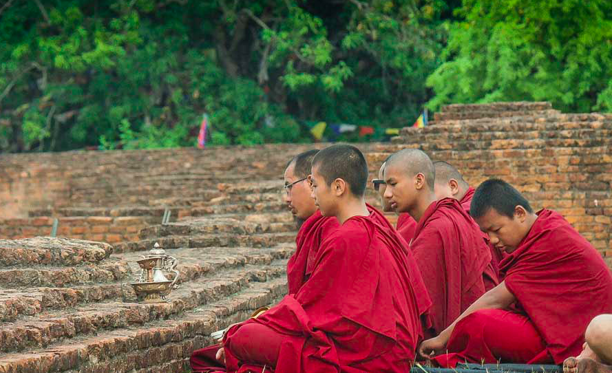Monks sitting in Lumbini