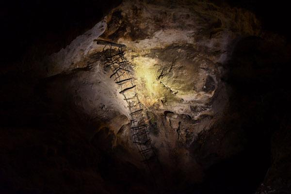 Spotlight on cave ladder at Carlsbad