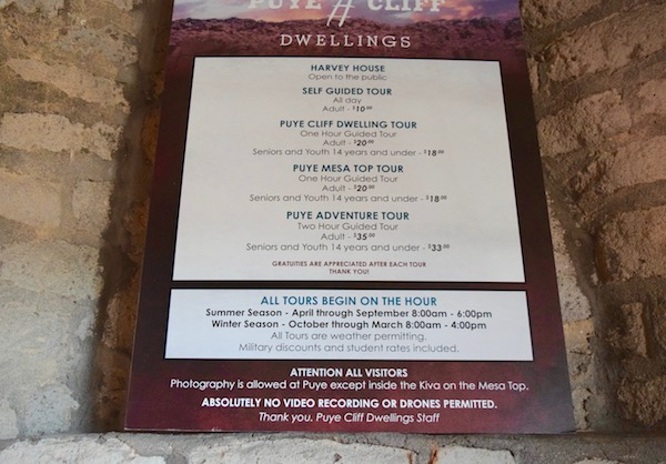 Entrance fees sign at Puye Cliff Dwellings