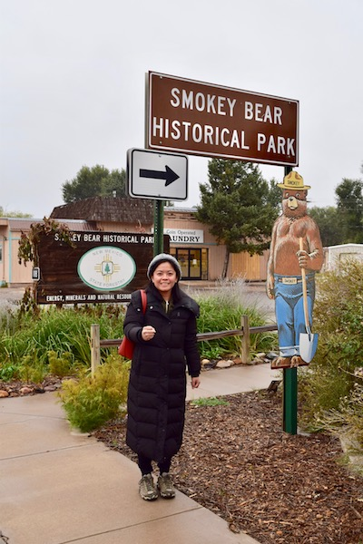 Tourist in front of Smokey Bear Historical Park