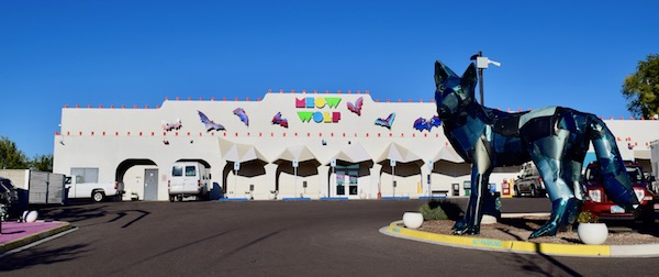 Meow Wolf building and dog sculpture outside - One of the best things to do in Santa Fe, NM