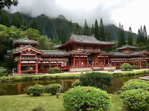 Red Japanese Byodo-In Temples surrounded by mountains and trees - Things to do in Oahi