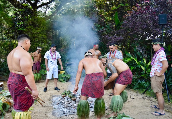 Men around a Luau cookout in Oahu itinerary