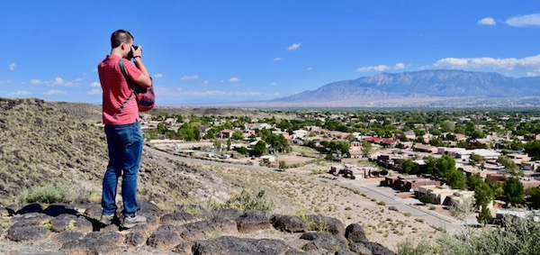 Things to do in Albuquerque - Man looking out at viewpoint at Volcano Park