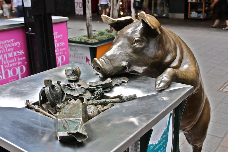 Bronze pigs sculpture over rubbish bin in Rundle Mall - Fun things to do in Adelaide