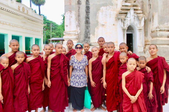 Girl with monks in Myanmar temple