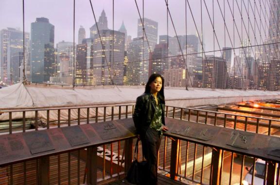 Girl on Brooklyn Bridge at twilight