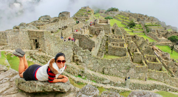 Girl with World Nomads travel insurance in front of Machu Picchu