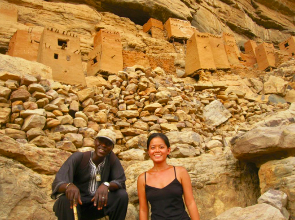 African and girl tourist in Dogon Country Mali for World Nomads insurance